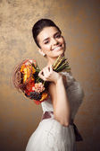 Beauty portrait of young bride. Perfect makeup and hairstyle. — Stock Photo