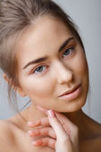 Studio portrait of beautiful woman with natural make-up — Stock Photo