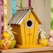 Easter composition - birdhouse and toys of chicken and eggs — Stock Photo #69485841