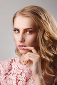 Beauty studio portrait of girl in pink dress with wavy hairstyle — Stock Photo