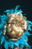 Creative hairstyle from hairpices. pineapple in feathers — Stock Photo