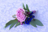 Purple rose boutonniere for the groom. Vintage — Stock Photo