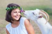 Funny picture a beautiful young girl farmer with a wreath on her — Stock Photo
