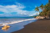 Beautiful tropical beach with black sand. Summer vacation concep — Stock Photo