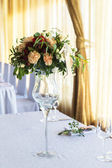 Floral arrangement for decoration wedding table for guests. Room — Stock Photo