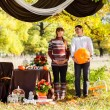 Beautiful Young Pregnant Couple Having Picnic in autumn Park. Ha — Stock Photo #55276897