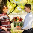Beautiful Young Pregnant Couple Having Picnic in autumn Park. Ha — Stock Photo #55276917