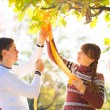 Beautiful Young Pregnant Couple Having Picnic in autumn Park. Ha — Stock Photo #55276927