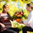 Beautiful Young Pregnant Couple Having Picnic in autumn Park. Ha — Stock Photo #55276929