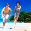 Happy young couple having fun on the shore of a tropical island. — Stock Photo #62293297