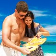 Happy young couple having fun on the shore of a tropical island. — Stock Photo #62293395