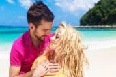 Newlyweds having fun on a tropical beach. Honeymoon — 图库照片