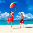 Young happy loving couple having fun in the tropical beach with — Stock Photo #62551103