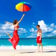 Young happy loving couple having fun in the tropical beach with — Stock Photo #62551145
