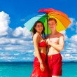 Young happy loving couple having fun in the tropical beach with — Stock Photo #62551163