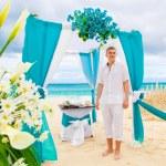 Wedding on the beach. The groom waits for the bride under the ar — Stock Photo #65112203