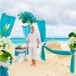 Wedding ceremony on a tropical beach in blue.The groom waits for — Stock Photo #65112391
