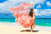 Young pregnant woman with pink cloth fluttering in the wind on a — Stock Photo