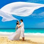 Asian bride and groom on a tropical beach. Wedding and honeymoon — Stock Photo #73772321