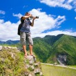 A man photographs the landscape. Rice terraces in the Philippine — Stock Photo #73781615