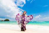 Young beautiful girl on the beach of a tropical island. Summer v — Stock Photo