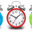 Red alarm clock front green and blue out of focus — Stock Photo #60048857