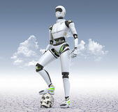Robot standing in the desert with his foot on the skull — Stock Photo