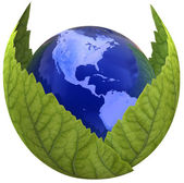 Globe inside green leafs  — Stockfoto