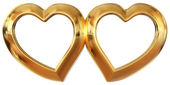 Golden photo frames in the form of hearts — Stock Photo