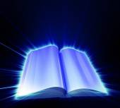 Opened book on black background and with blue glow — Stock Photo