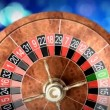 Casino roulette wheel against defocused background — Stock Video #60194811