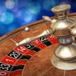 Casino roulette wheel against defocused background — Stock Video #60194873