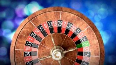 Casino roulette wheel against defocused background — Vídeo stock