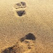 Footprints on the dry sand. Blurred image. Can be used as backgr — Stock Photo #54110629