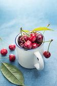 Fresh cherries in a mug — Stock Photo