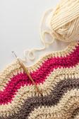 Crochet hook with crocheted blanket — Stock Photo