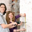 Young couple repairing apartment — Stock Photo #52477045