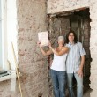 Young couple with property deed — Stock Photo #52477217