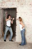 Young pair does repair — Stock Photo