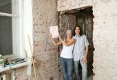 Young couple with property deed — Stock Photo