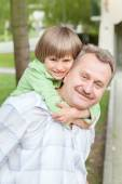 Grandad play with grandson — Stock Photo