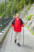 Elderly man hikes on trail — Foto Stock