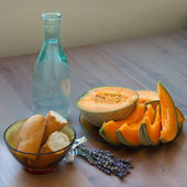 French baguette, melon and bottle of water — Stock Photo