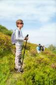 Boy on mountain path — Stock Photo