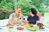 Mature couple clink glasses of wine — Stock Photo