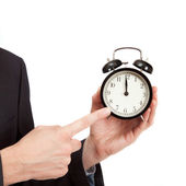 Pointing finger on clock — Stock Photo