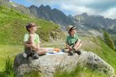 Boys  in summer mountains — Stock Photo