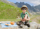 Boy in summer mountains — Stock Photo