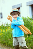 Boy with two baguettes — Stock Photo