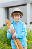 Boy with baguettes — Stock Photo